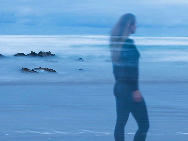 Woman wearing black on the beach at night, New Zealand Beach, New Zealand Ocean photographer, Ocean Artist in New Zealand, New Zealand Artist Outdoor Studio, Impressionistic Photography