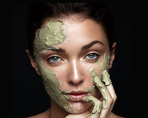 Women with Coconut Matcha Brightening Mask on her face.