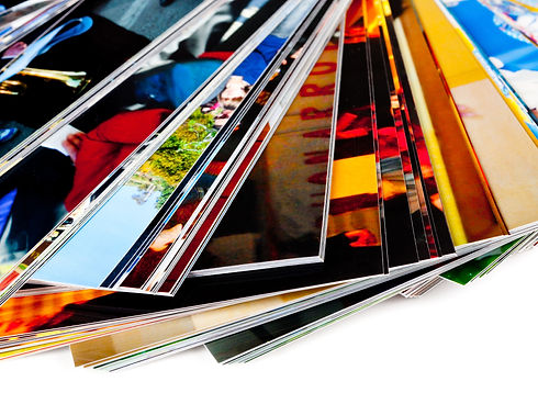A pile of printed photographs.