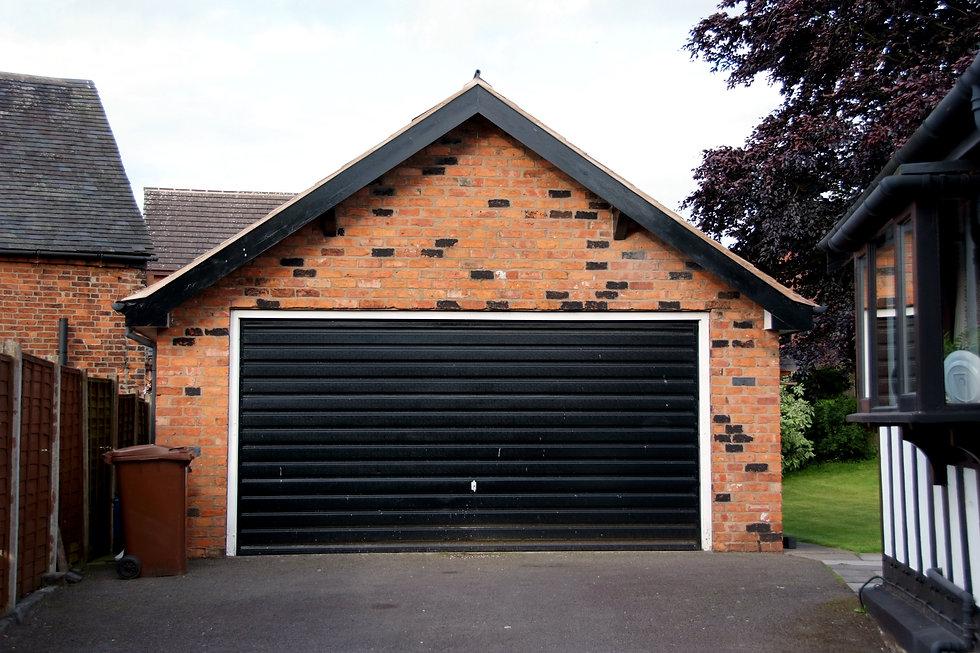Black roller door on a modern garage.jpg