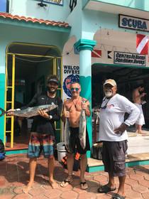 Ariel, Manu fishing in Isla Mujeres.