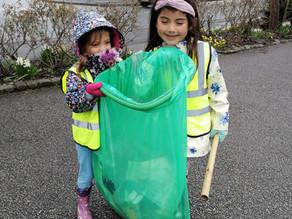 Village Children picking up litter and weeds.