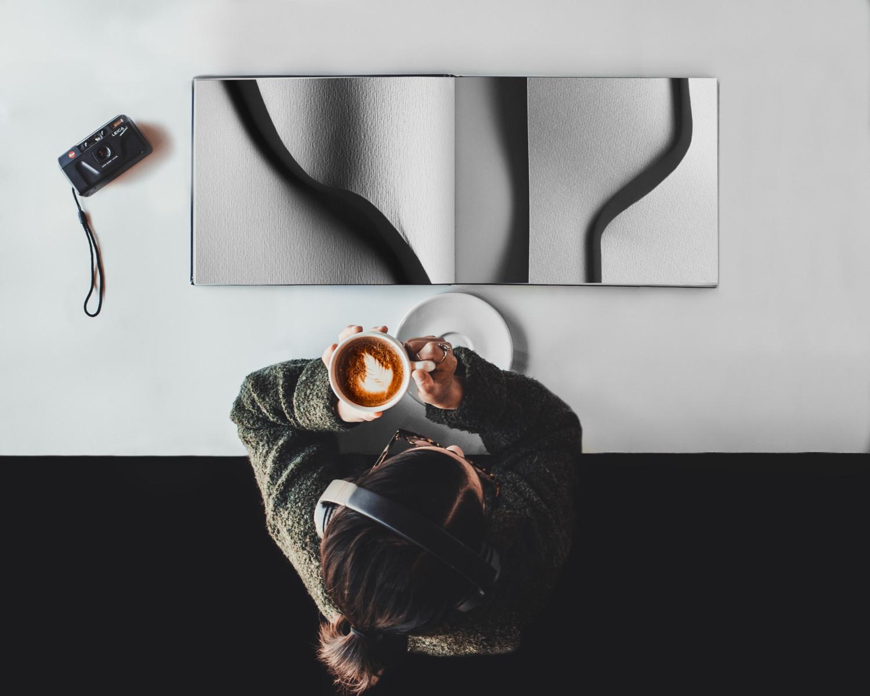 Woman reading coffee table book.jpg