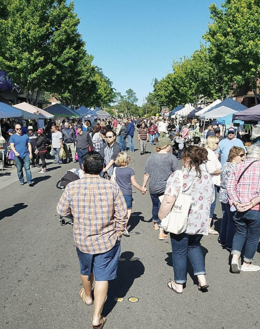 Faire-Goers Shopping Downtown