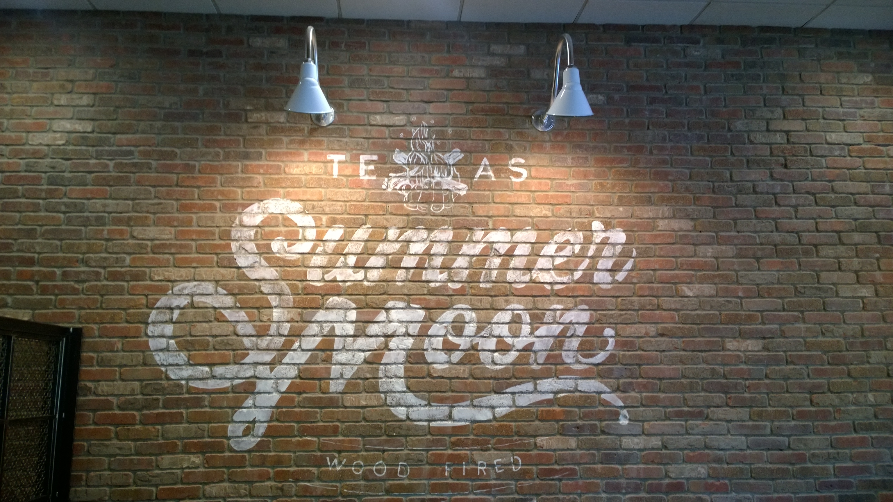 Summer Moon on 620 Sign on Brick
