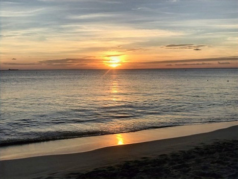 Enjoying a sunset at Rainbow beach, Frederiksted, St. Croix. Welcome Keith B.!