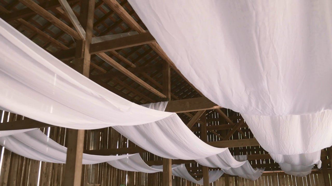 44 White Draping over Rails Inside Barn.