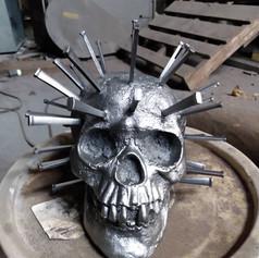 cast iron covid skull.jpg