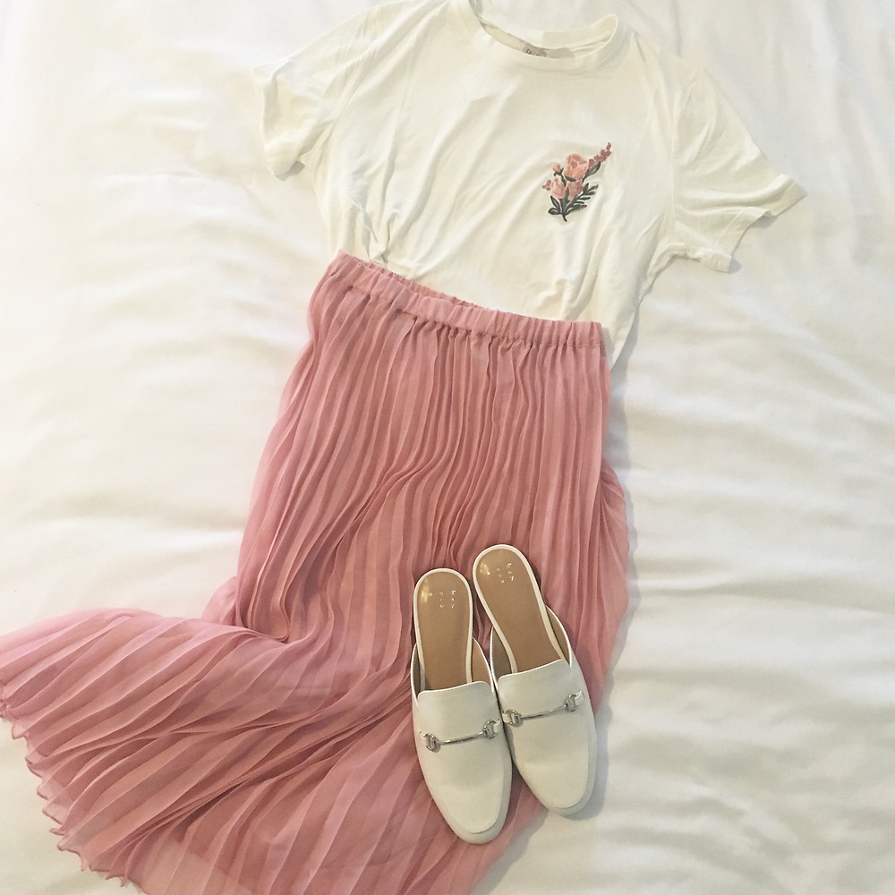 pink pleated skirt with floral top