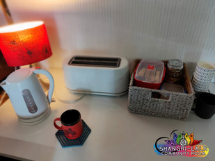 A Tea & Coffee corner, fridge, airfryer, toaster, hob available.