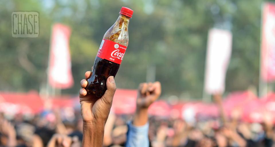Holding a Bottle of Coke