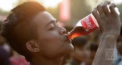 Young Man Drinking Coke in Myanmar