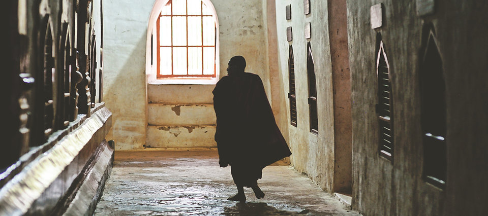 The silhouette of a Buddhist monk in a temple in Bagan, Myanmar.