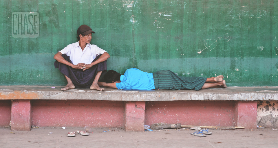 Burmese Men Resting at a Train Stop