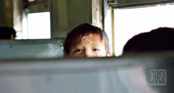 Burmese Boy on a Train in Myanmar