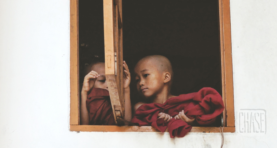Novice Monks Peek out of a Window