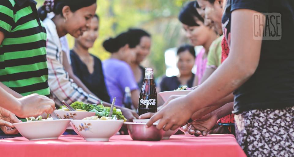 Bottle of Coke on a Dinner Table