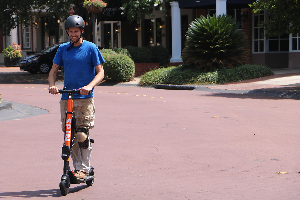 Andy Prescott rides on a Spin e-scooter on the day the City of Tallahassee launched its pilot program.