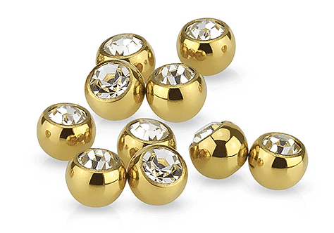 Boule anodise or strass serti pour piercing