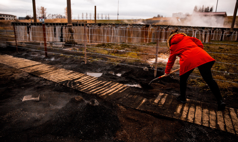 Icelandic women using geothermal heat from ground to bake bread.