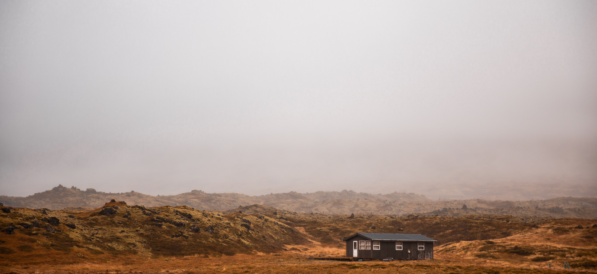 Lone house with foggy bakcground in Iceland