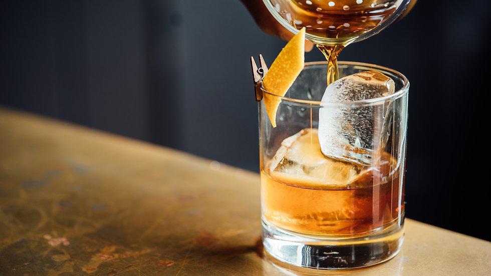 liquor%20pouring%20on%20clear%20shot%20glass_edited.jpg