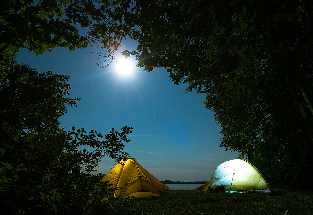 Two tents in moonlight.
