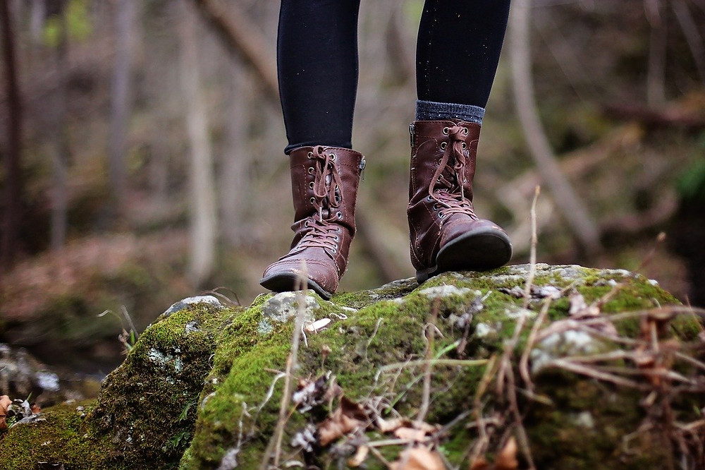 Boots on rock and moss
