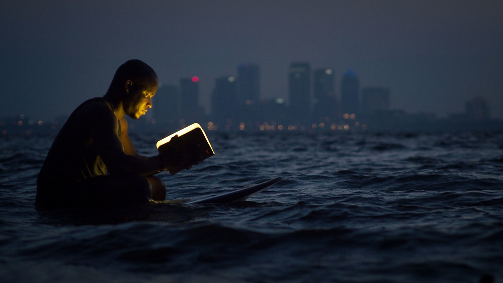 Man, book, surf, city, poetry of life