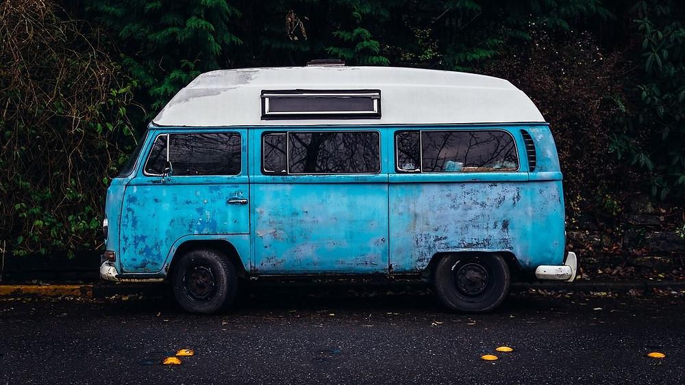 Old VW Microbus camper. Bird's-egg blue. Facing Sideways.