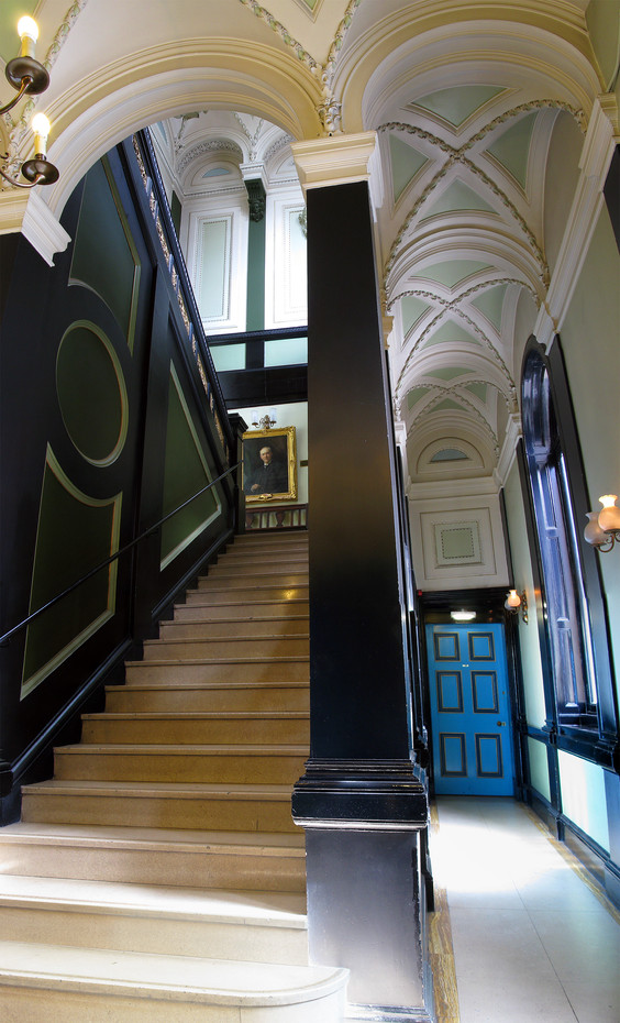 Staircase leading to the main library and ground floor corridor leading to the small library