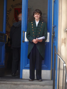 A volunteer at a previous Doors Open Day wearing the Royal Faculty doorman's uniform
