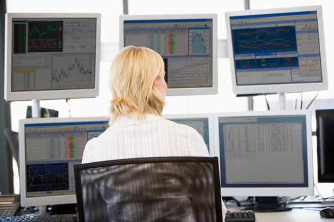 photodune-316686-stock-trader-looking-at-multiple-monitors-xs.jpg