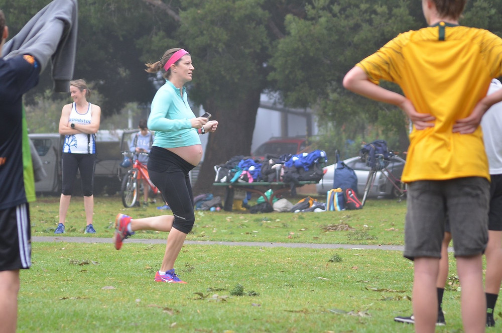 Image of me running at 36 weeks pregnant