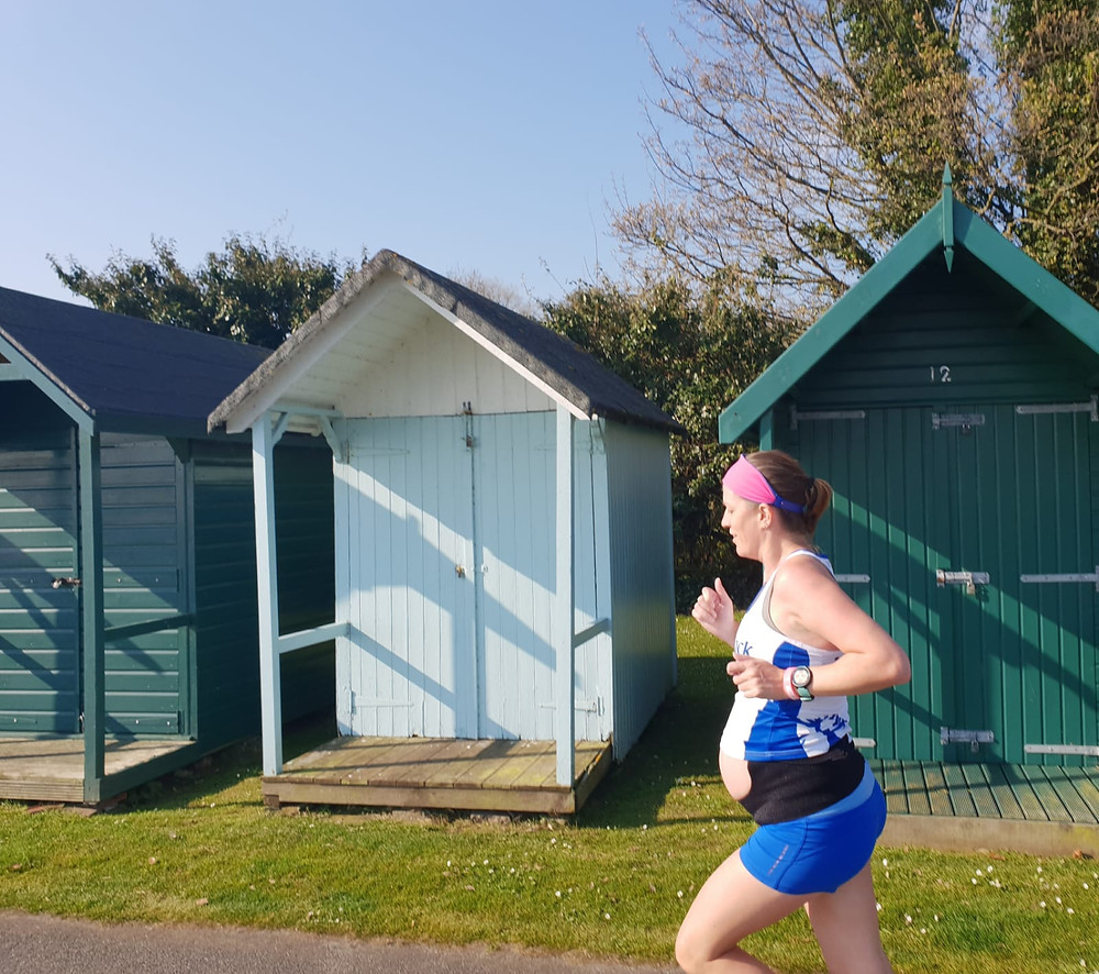 Image of me running while I was pregnant