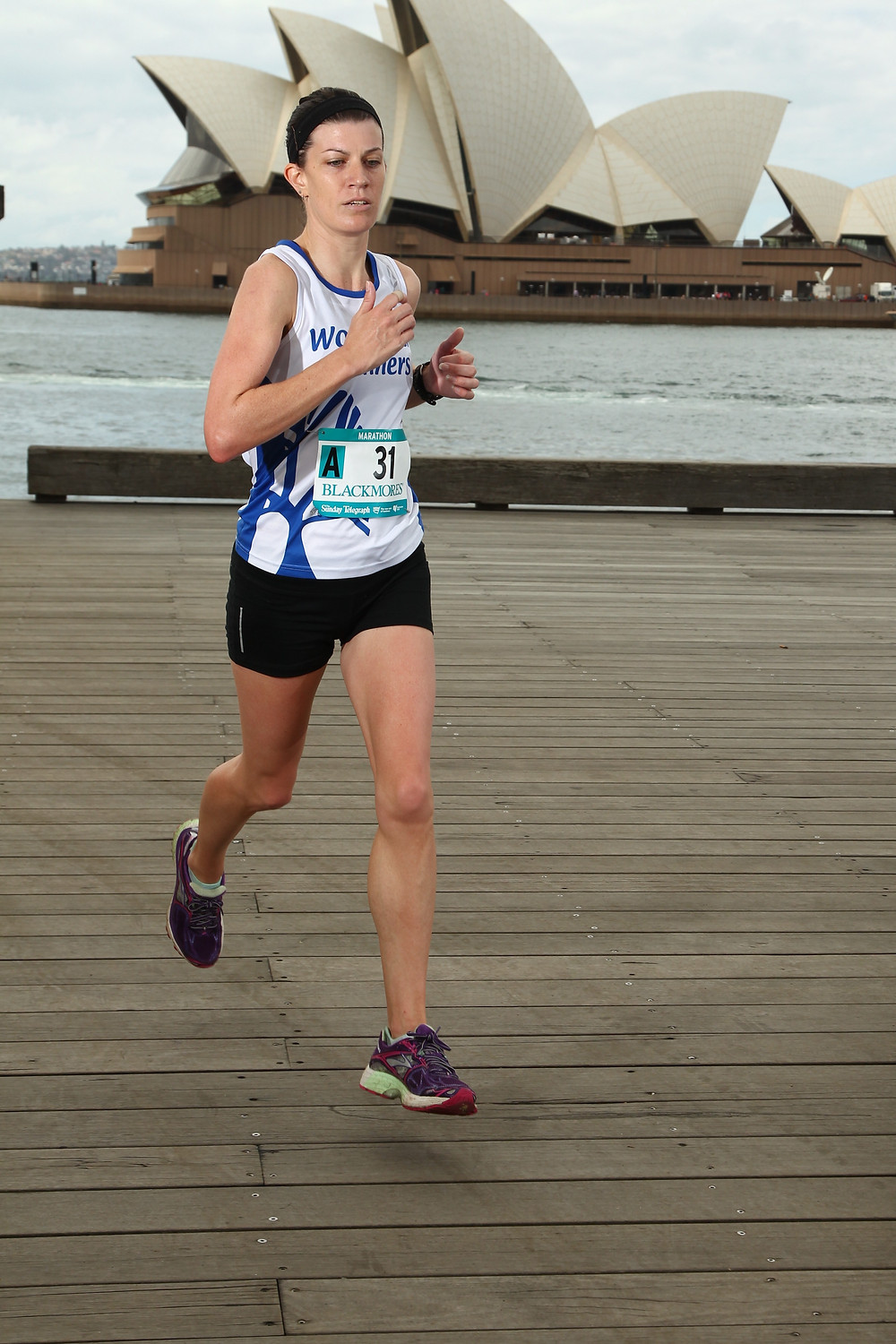 Image of me running in front of the Opera House inthe 2014 Sydney Marathon