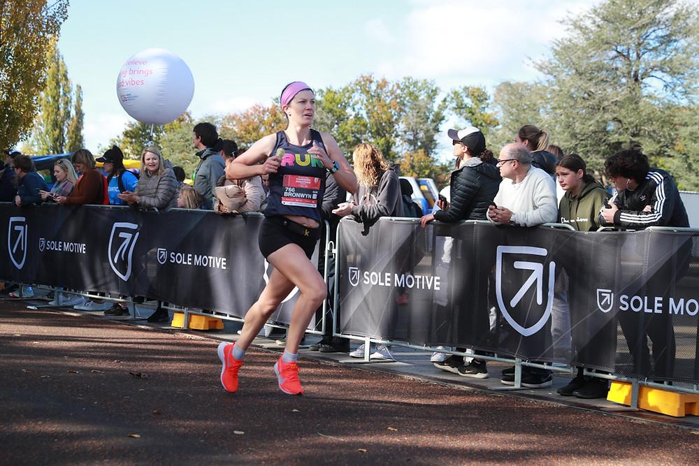 Image of me finishing the 2021 Canberra Marathon