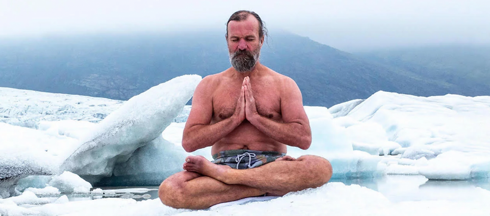 photo of wim hof sitting in ice as an example of the Icemans dedication to cold exposure