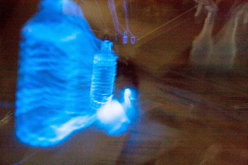 Glow stick fluid in water - Light painting by Samantha Voros