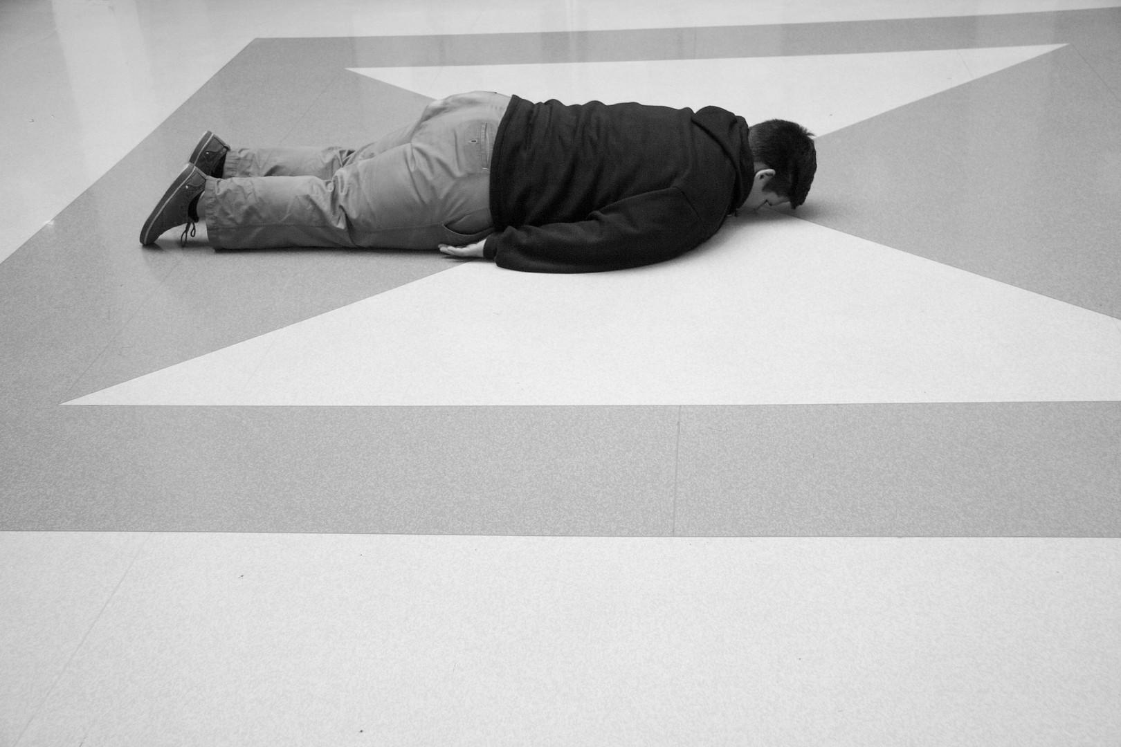 facing down on the floor in cross hair