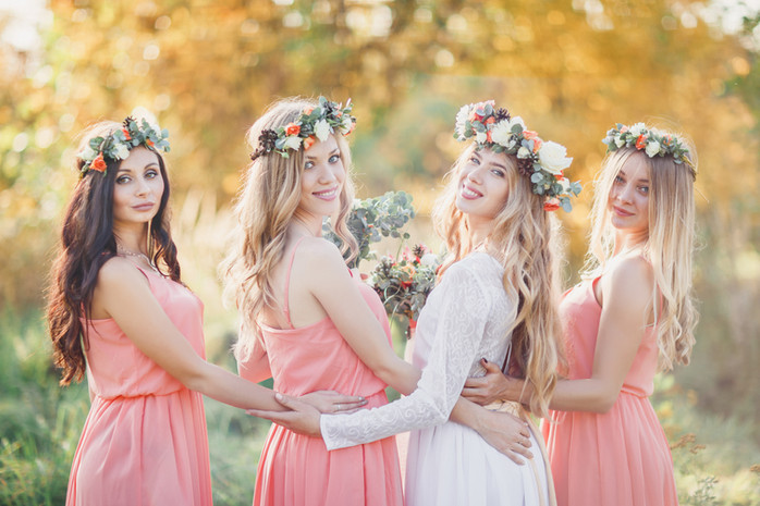 Bride with bridesmaids in pink dresses.