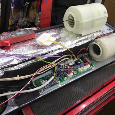 whale-under-floor-heater-repair.jpg