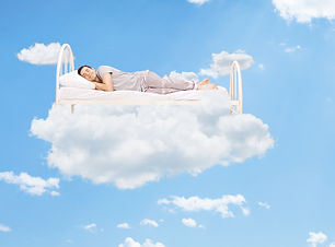 Man sleeping on a bed in the clouds high