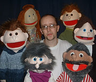 Simon with puppets.JPG