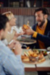 Multiethnic friends sitting at restauran