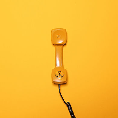 Retro yellow telephone tube on yellow ba