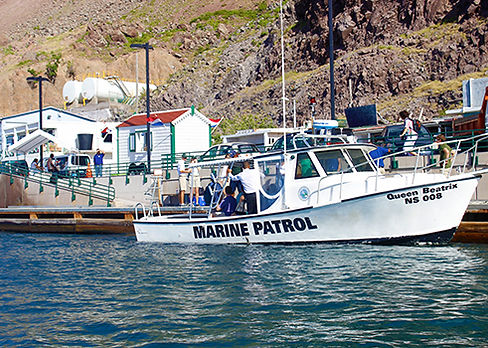 """The Saba Marine Park's Patrol boat the """"Queen Beatrix"""", ferries passengers to Fort Bay from Crystal Cruises' Crystal Esprit super yacht. Image by malachy multimedia n.v."""