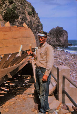 July 1964. Leslie Johnson here with one of the many fishing boats which he built.