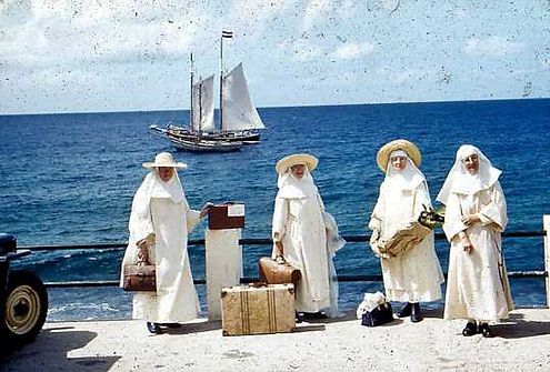 Dominican Nuns here getting ready to go for their annual vacation with the government schooner The Blue Peter at the Fort Bay.