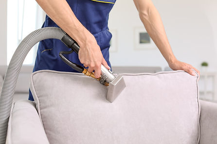 Dry cleaning worker removing dirt from a